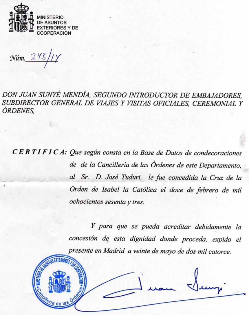 DOCUMENTO QUE CERTIFICA LA CONCESIÓN DE LA CRUZ DE LA ORDEN DE ISABEL LA CATÓLICA EXPEDIDO POR EL MINISTERIO DE ASUNTOS EXTERIORES